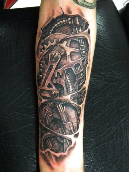Arm Biomechanical Gear Tattoo by Bad Apples Tattoo
