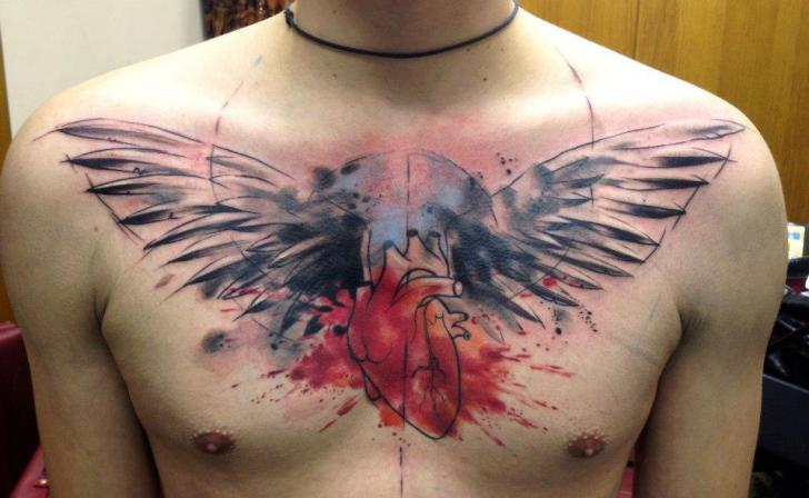 Chest Heart Wings Tattoo by Tribo Tattoo