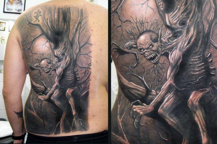 Tatuaje Fantasy Espalda Iron Maiden por Javier Tattoo