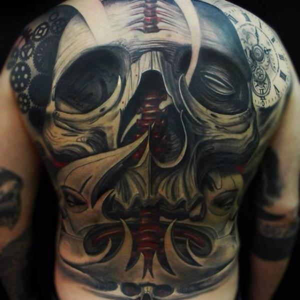 Biomechanical Skull Back Tattoo by Javier Tattoo