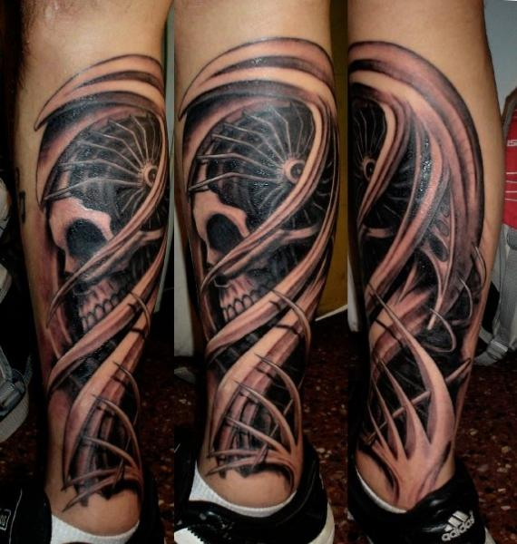 Biomechanical Calf Skull Tattoo by Javier Tattoo