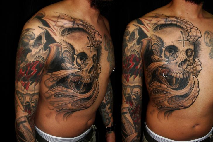 Shoulder Biomechanical Chest Skull Tattoo by Javier Tattoo