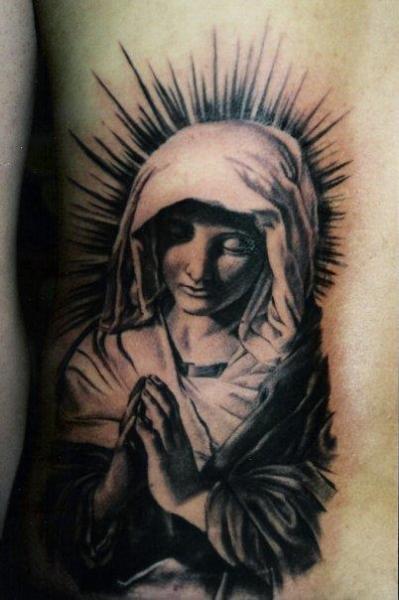 Tatuaje Lado Religioso por Carlos Torres