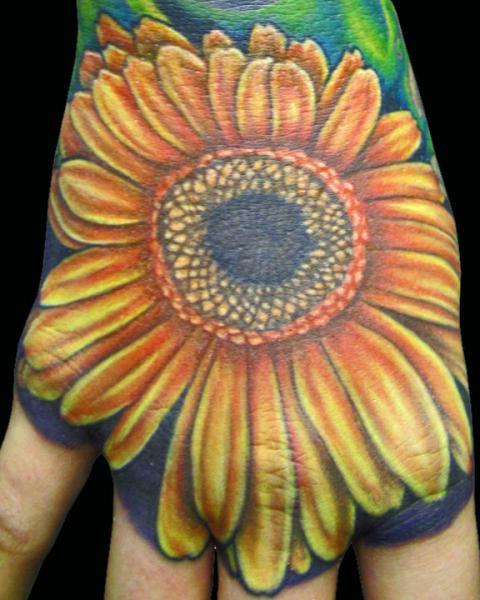 Flower Hand Tattoo by Logan Aguilar