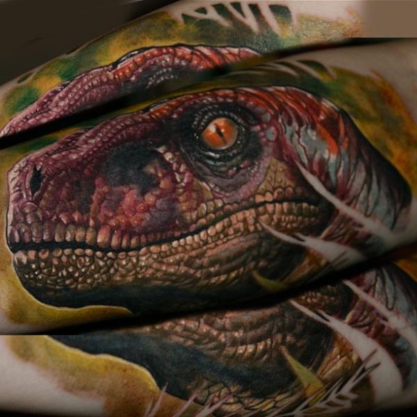 Realistic Dinosaur Tattoo by Reinkarnation Tattoos