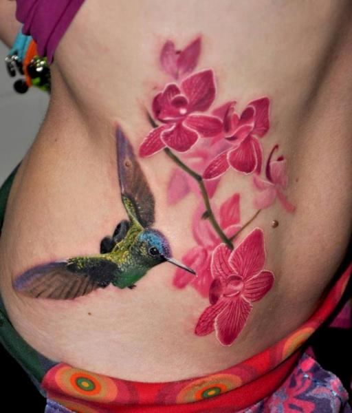 Realistic Flower Side Hummingbird Tattoo by Nadelwerk
