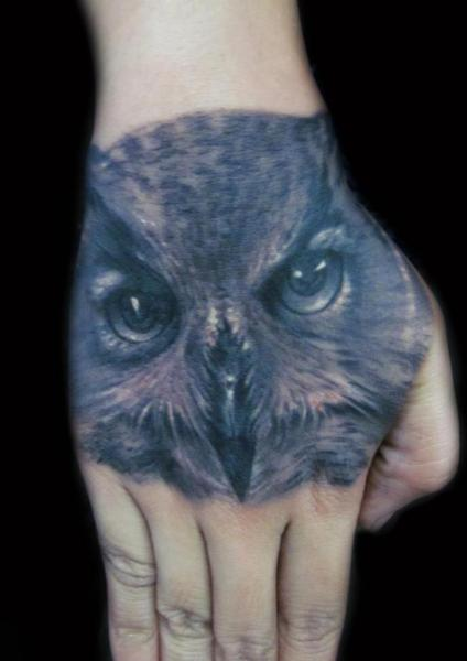 Realistic Hand Owl Tattoo by Carl Grace