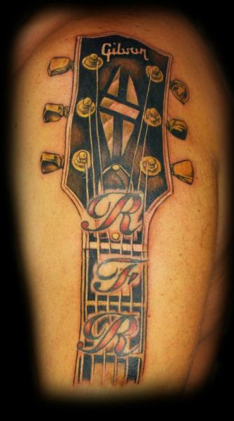 Shoulder Realistic Guitar Tattoo by Tattoo Empire
