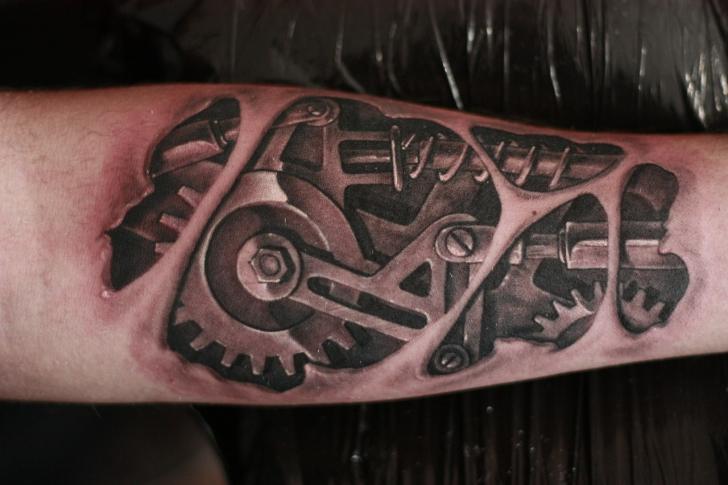 Arm Biomechanical Tattoo by Baraka Tattoo