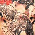 Realistic Chest Flower Belly Dove tattoo by Saved Tattoo