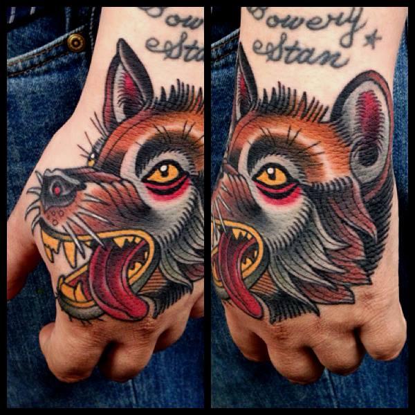 Old School Hand Wolf Tattoo by Montalvo Tattoos
