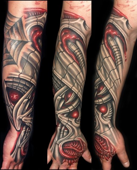Arm Biomechanical Hand Tattoo by Tattoo by Roman