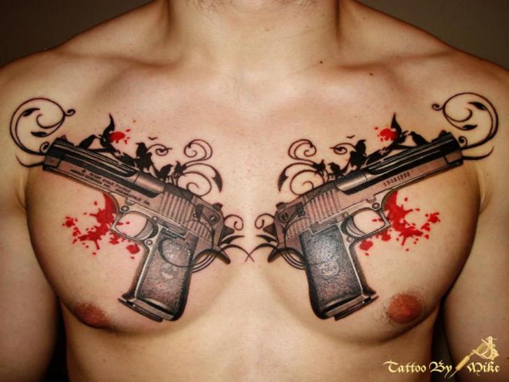 Realistic Chest Gun Tattoo by Tattoo Rascal