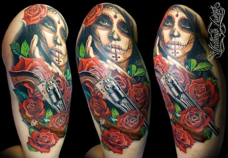 Realistic Flower Gun Tattoo by Tattoo Rascal