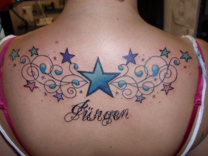 Leuchtturm Stern Rücken Tattoo von Fatink Tattoo
