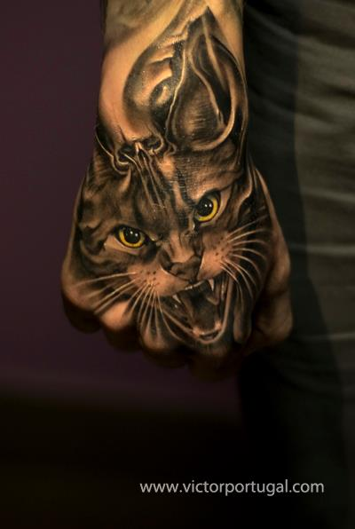 Realistic Hand Cat Tattoo by Victor Portugal