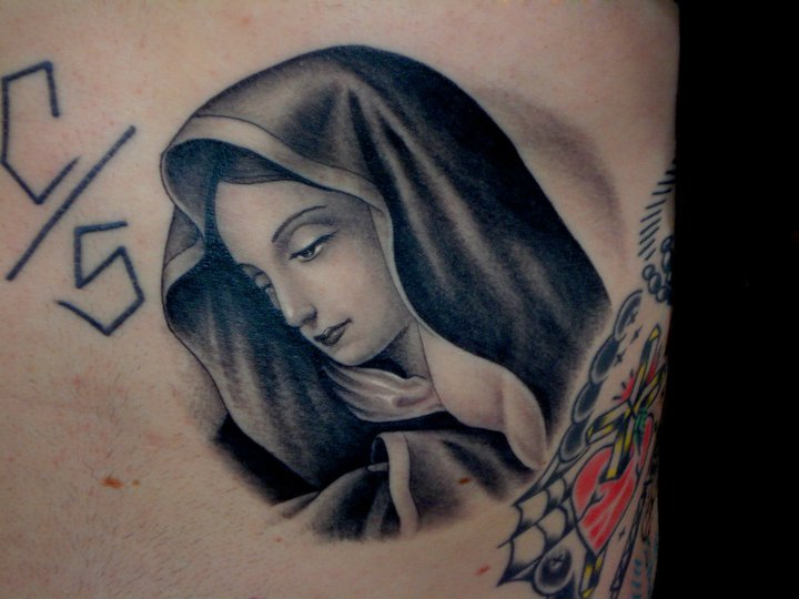 Tatuaggio Fianco Religiosi di Salt Water Tattoo