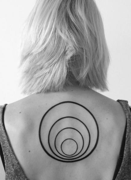 Back Circle Tattoo by 2 Spirit Tattoo