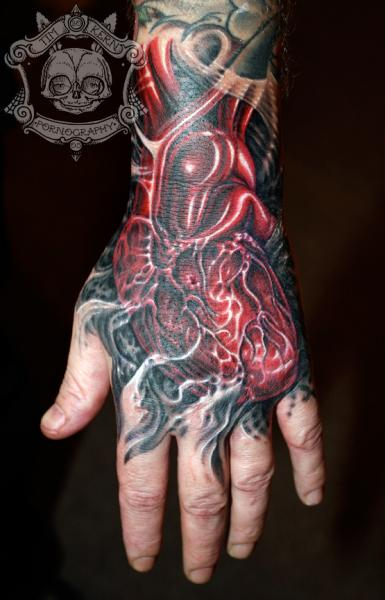 Biomechanical Heart Hand Tattoo by Tim Kerr