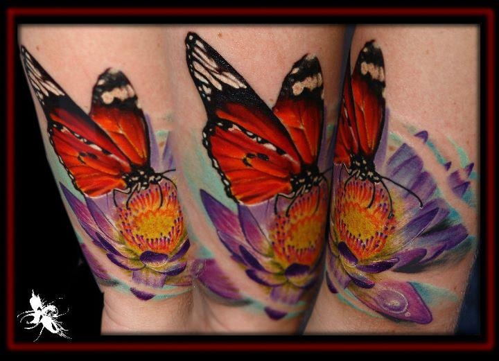 Realistic Flower Butterfly Tattoo by Dark Art Tattoo
