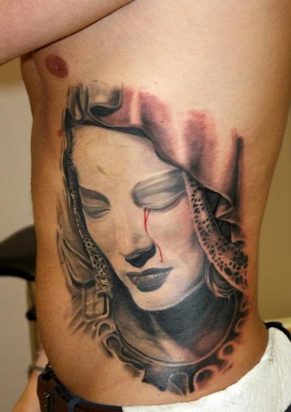 Side Religious Tattoo by Dark Art Tattoo