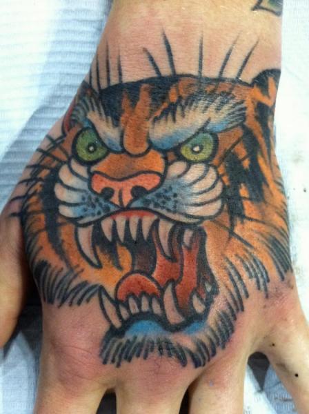 New School Hand Tiger Tattoo by Chad Koeplinger