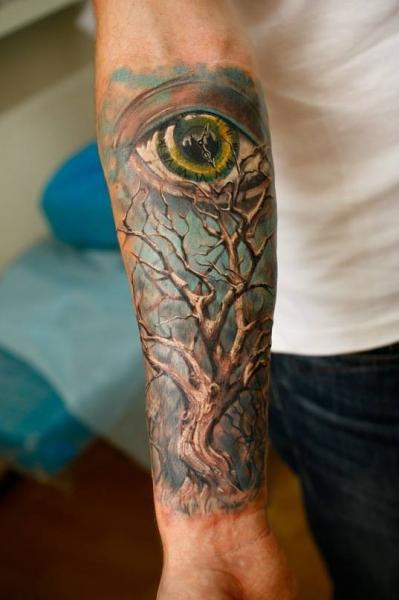 Arm Realistic Eye Tree Tattoo by Ivan Yug