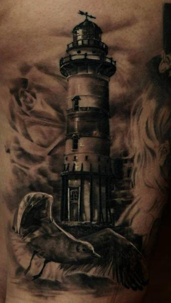 Realistic Lighthouse Bird Tattoo by Ivan Yug