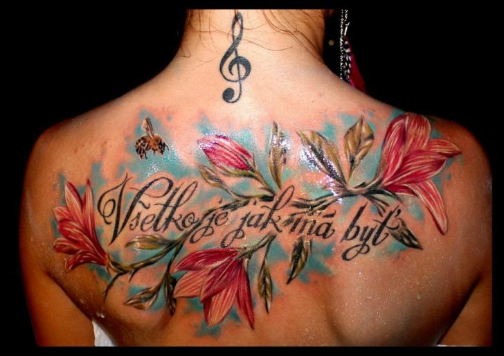 Flower Lettering Back Tattoo by Delirium Tattoo