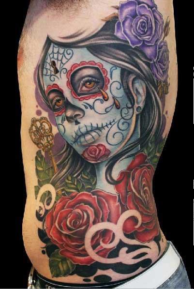 Flower Side Mexican Skull Tattoo by Dzy Tattoo