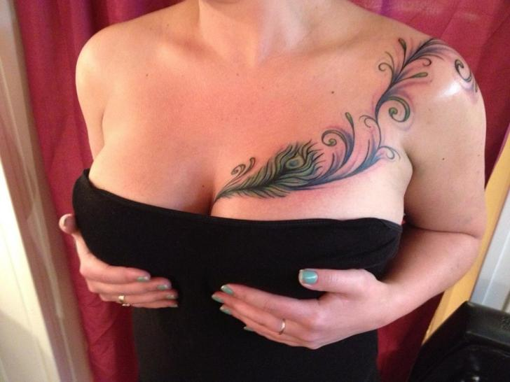 Feather Breast Tattoo by Art and Soul Tattoo