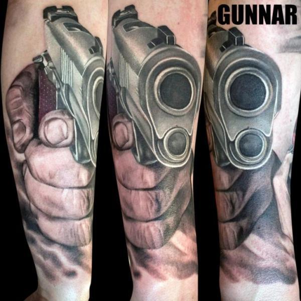 Arm Realistic Gun Tattoo by Attitude Tattoo Studio