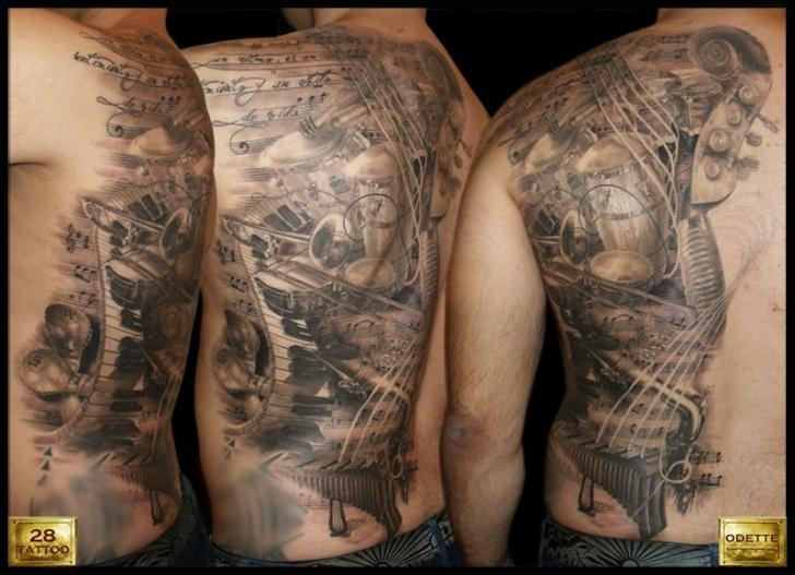 Realistic Back Music Tattoo by 28 Tattoo