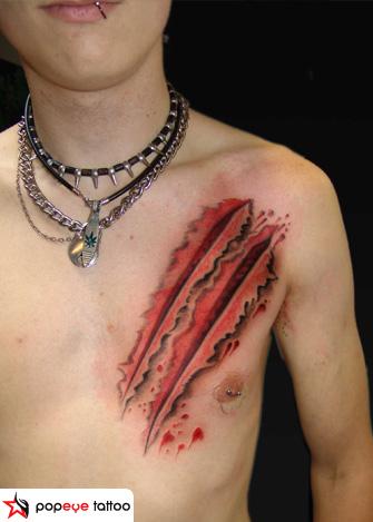 Chest Scar Tattoo by Popeye Tattoo