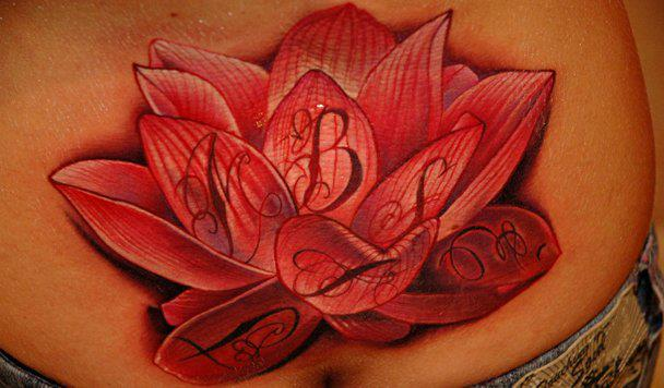 Realistic Flower Lettering Back Tattoo by Black Rose Tattoo