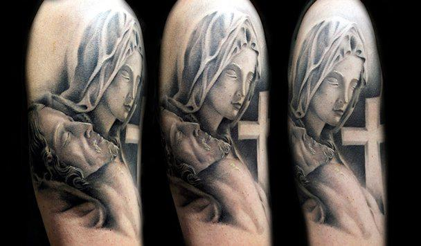 Shoulder Religious Tattoo by Black Rose Tattoo