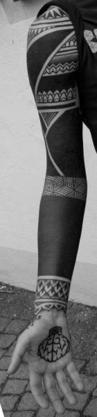 Hand Tribal Sleeve Tattoo by Mahakala Tattoo