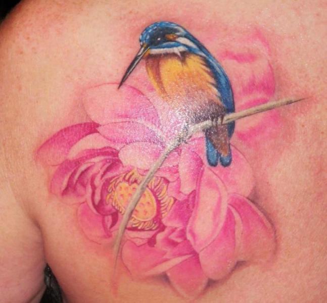 Realistic Flower Back Bird Tattoo by Csaba Kiss