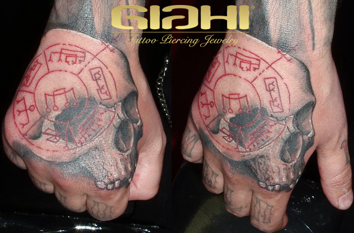 Skull Hand Symbol Tattoo by Giahi