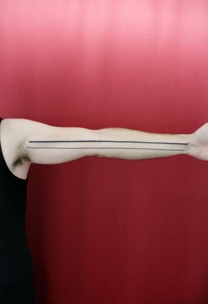 Arm Line Tattoo by Skin Deep Art