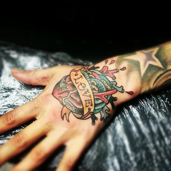 New School Heart Hand Tattoo by Stay True Tattoo