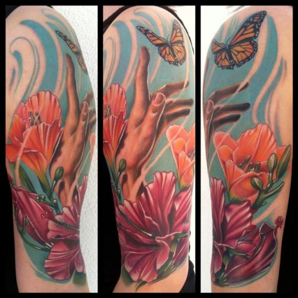 Shoulder Realistic Flower Hand Butterfly Tattoo by Art Junkies Tattoos