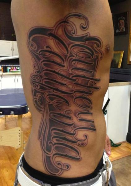 Side Lettering Tattoo by Art Junkies Tattoos