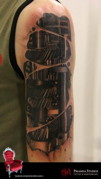Shoulder Arm Biomechanical Gear Tattoo by Piranha Tattoo Supplies