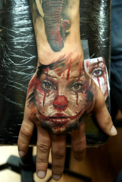 Fantasy Clown Hand Tattoo by Bloodlines Gallery