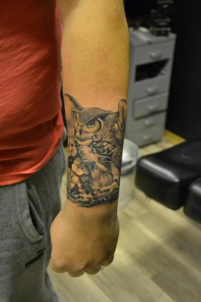 Arm Realistic Owl Tattoo by Crazy Needle