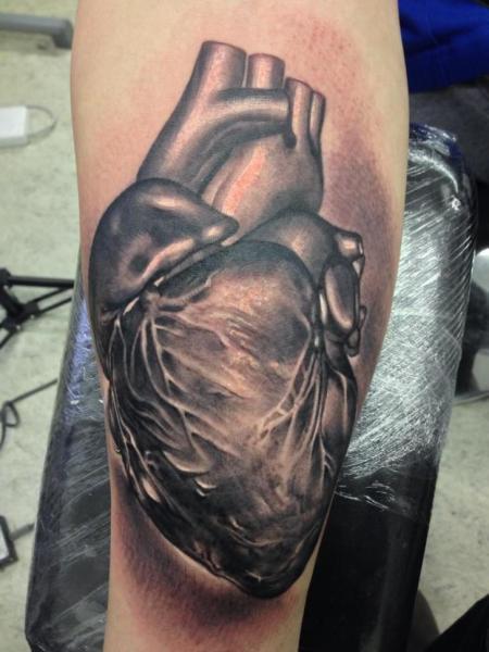 Arm Realistic Heart Tattoo by Putka Tattoos