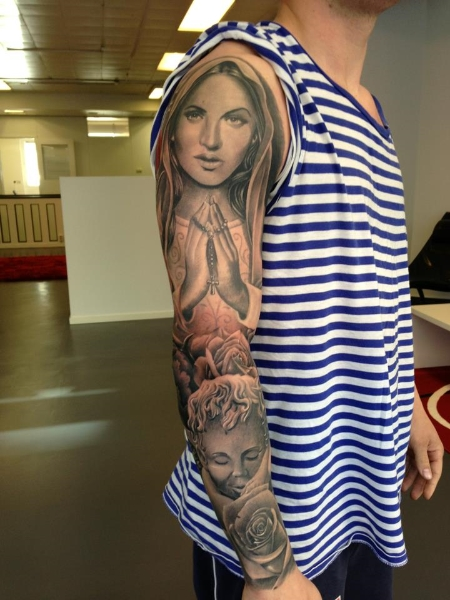 Religious Sleeve Tattoo by No Remors Tattoo