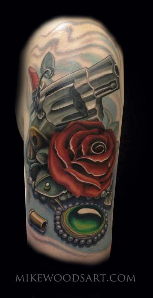 Arm Flower Gun Tattoo by Mike Woods