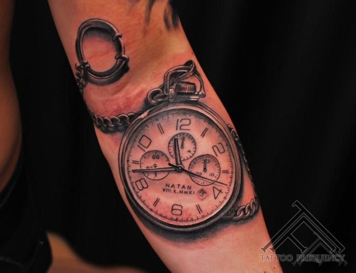 Arm Realistic Clock Tattoo by Tattoo Frequency
